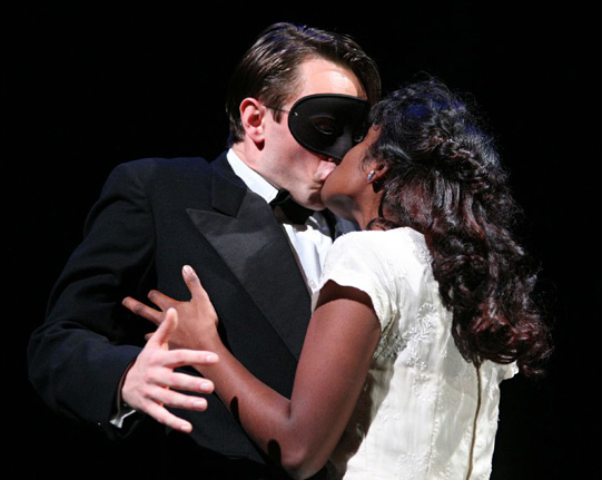 Romeo (David Dawson) receives another kiss from Juliet (Anneika Rose) at the ball.