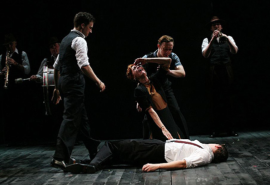 Lady Capulet (Éva Magyar) mourns Tybalt (Mark Holgate) who has been killed by Romeo.