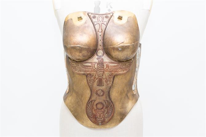 A gold breastplate with Egyptian-style markings