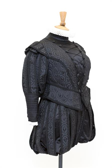 Judi Dench's black doublet and hose with a small white ruff.