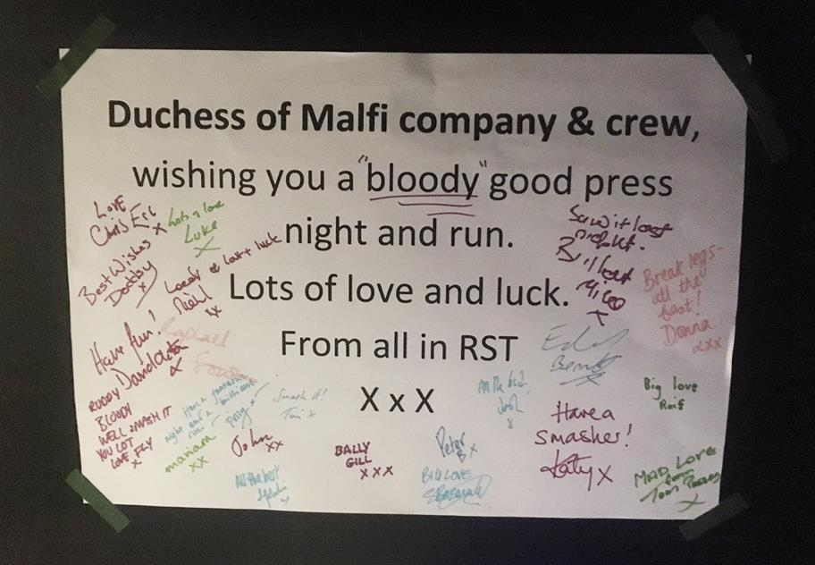sign reading 'Duchess of Malfi cast & crew wishing you a bloody good press night and run. Lots of love and luck. From all in RST.' Signed by actors