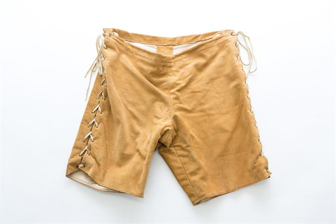 A pair of tan shorts with thick stitching