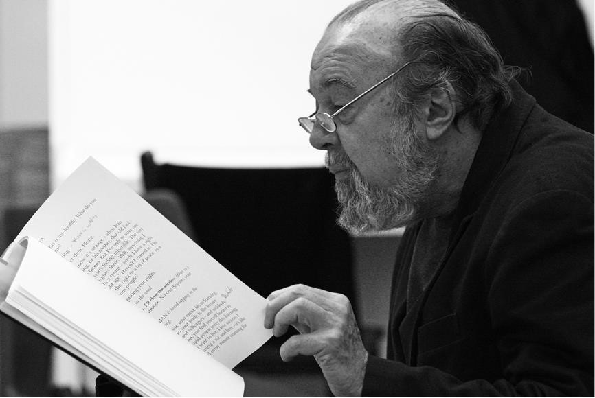 Peter Hall in black and white reading a script