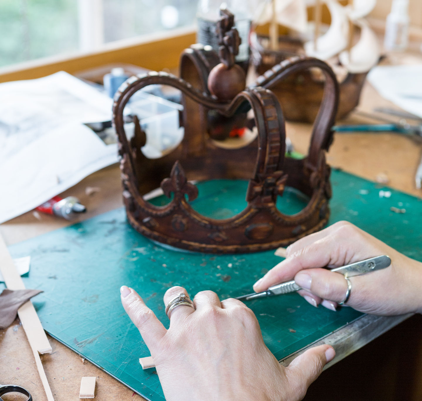 hands in a workshop making a crown