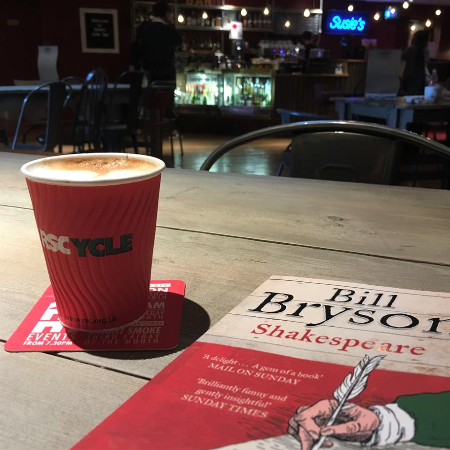 a coffee and a book on a table at Susie's Cafe Bar at The Other Place