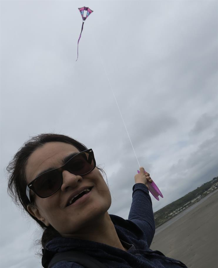 Amina flying a kite
