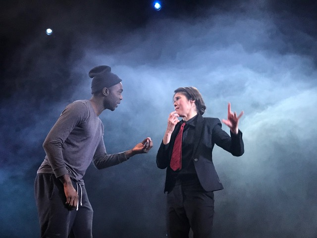 Paapa Essiedu as Hamlet on stage with Becky Barry, the British Sign Language interpreter