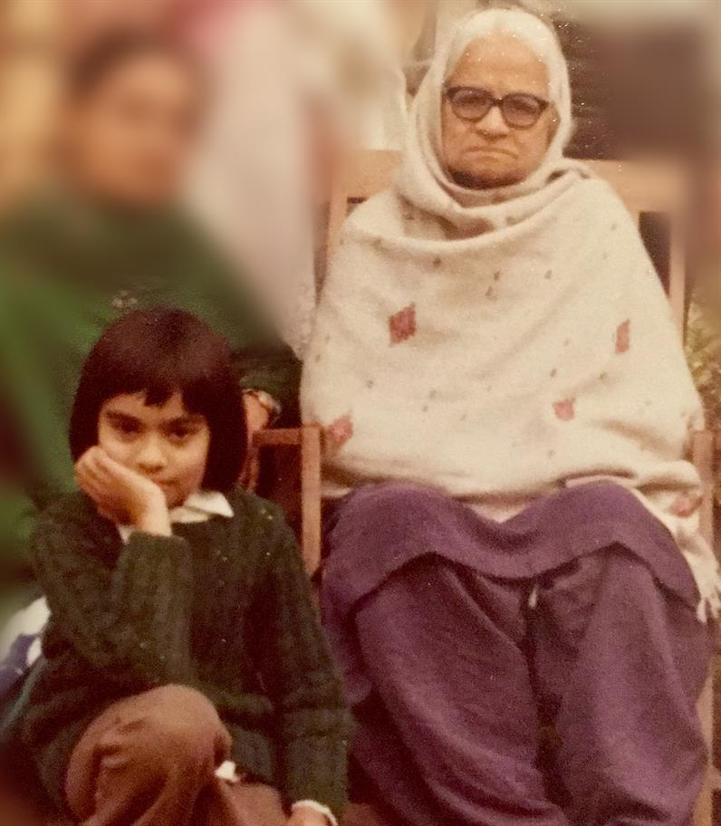 A young Amina with her grandmother.