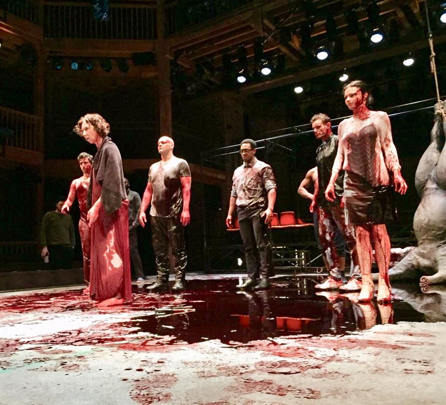The understudy cast of The Duchess of Malfi on stage, drenched in blood