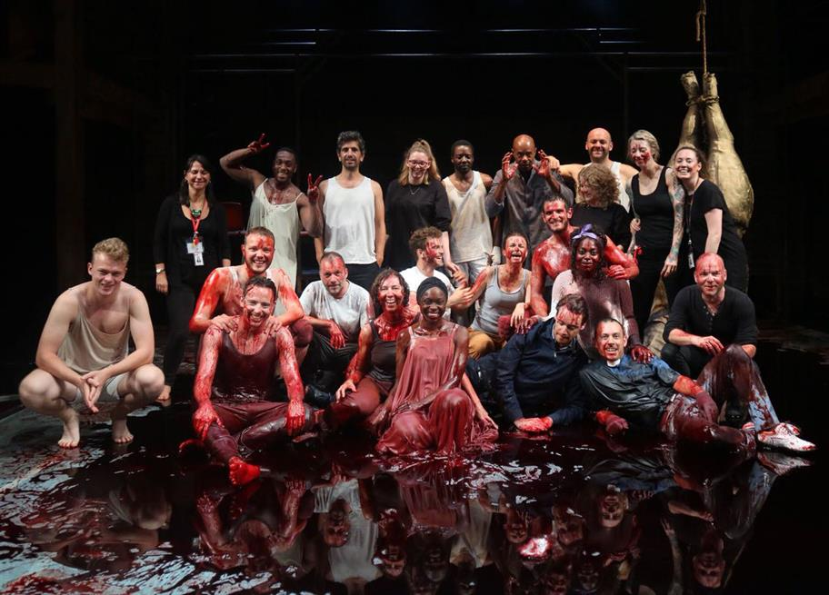 The cast and creatives of The Duchess of Malfi covered in blood.
