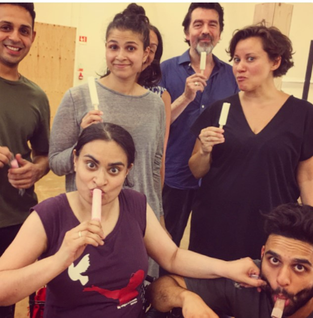 The Tartuffe cast eating ice lollies.