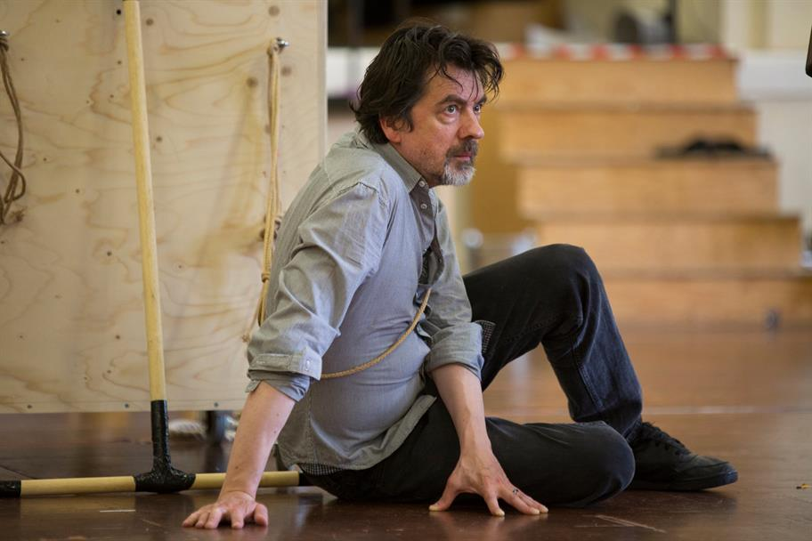 James Clyde sits on the floor in a rehearsal for Tamburlaine.