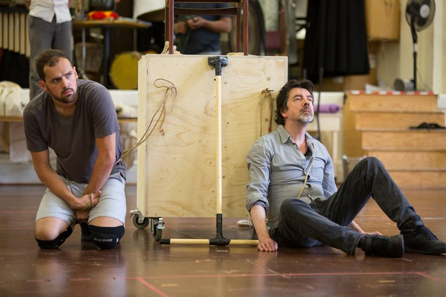 Ralph Davis and James Clyde are strapped to a cart during Tamburlaine rehearsals.