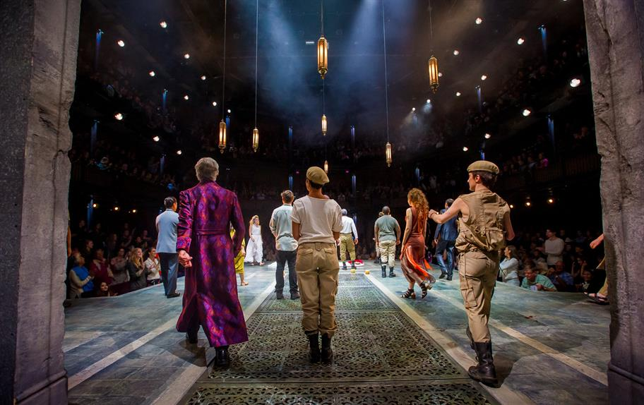 view from the back of the stage of the cast assembled for applause
