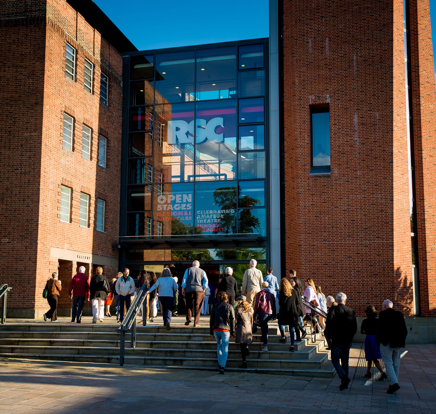 the outside of the RSC on a busy, sunny day with people going in and out