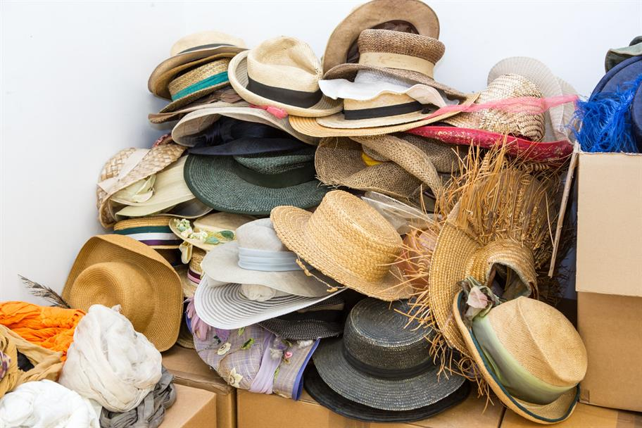 a pile of assorted hats