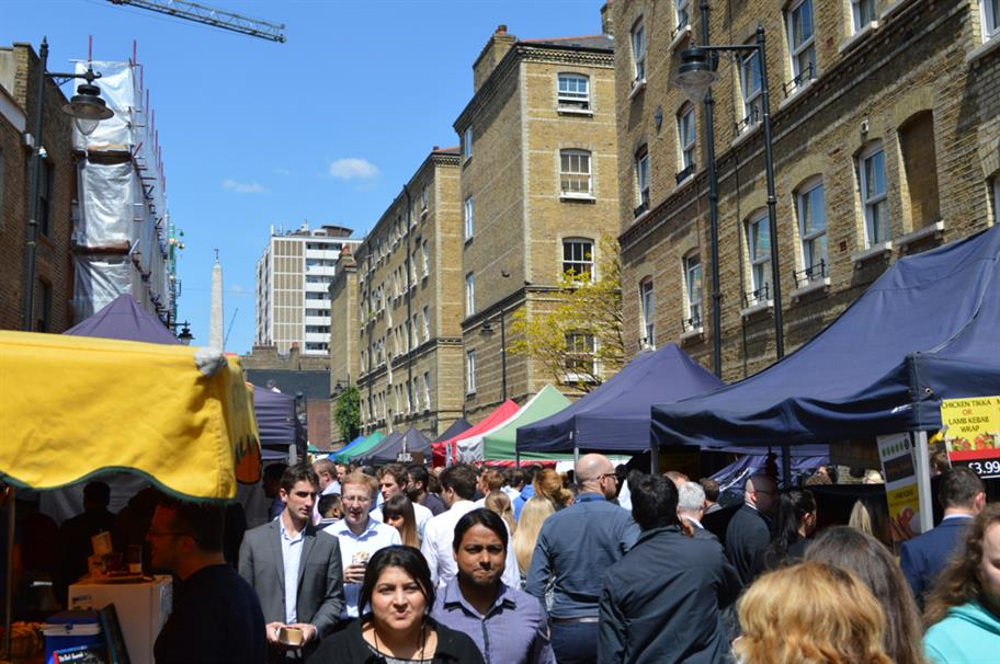 People walking through Whitecross Street Market.