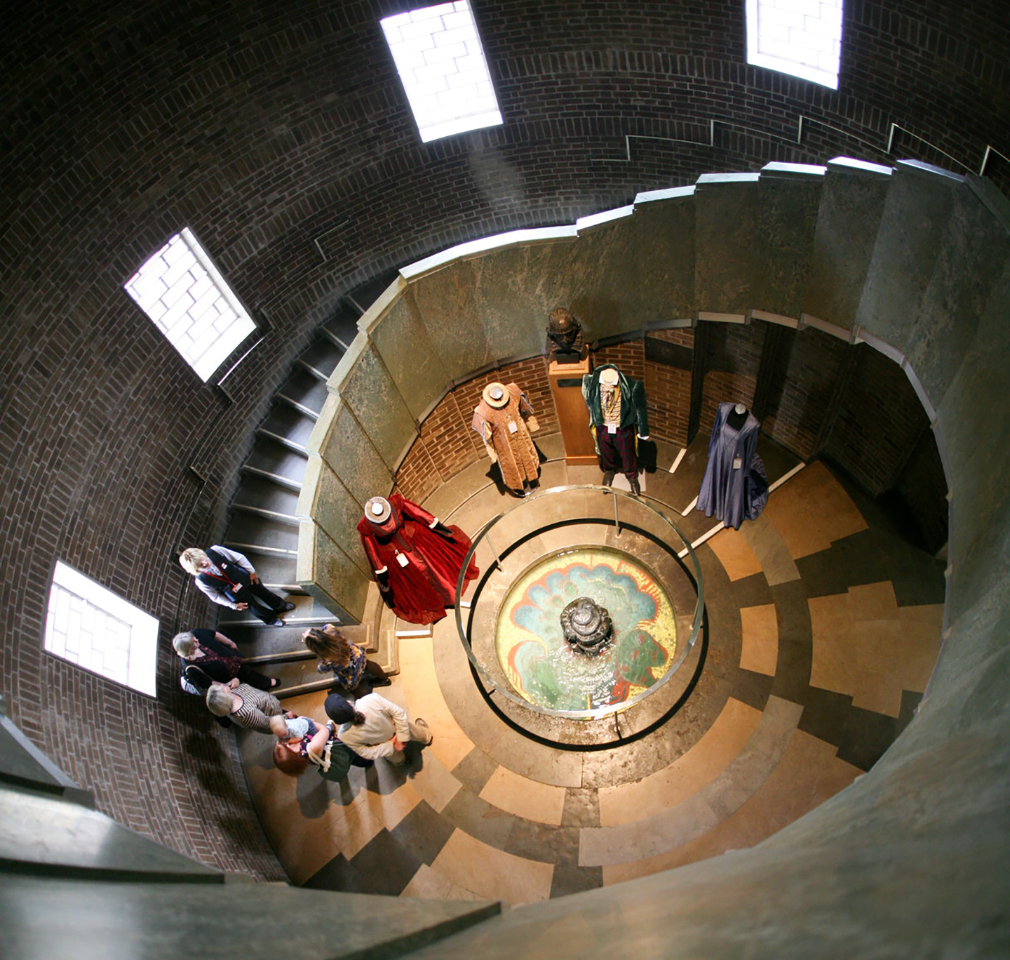 View of costumes at the bottom of a spiral staircase