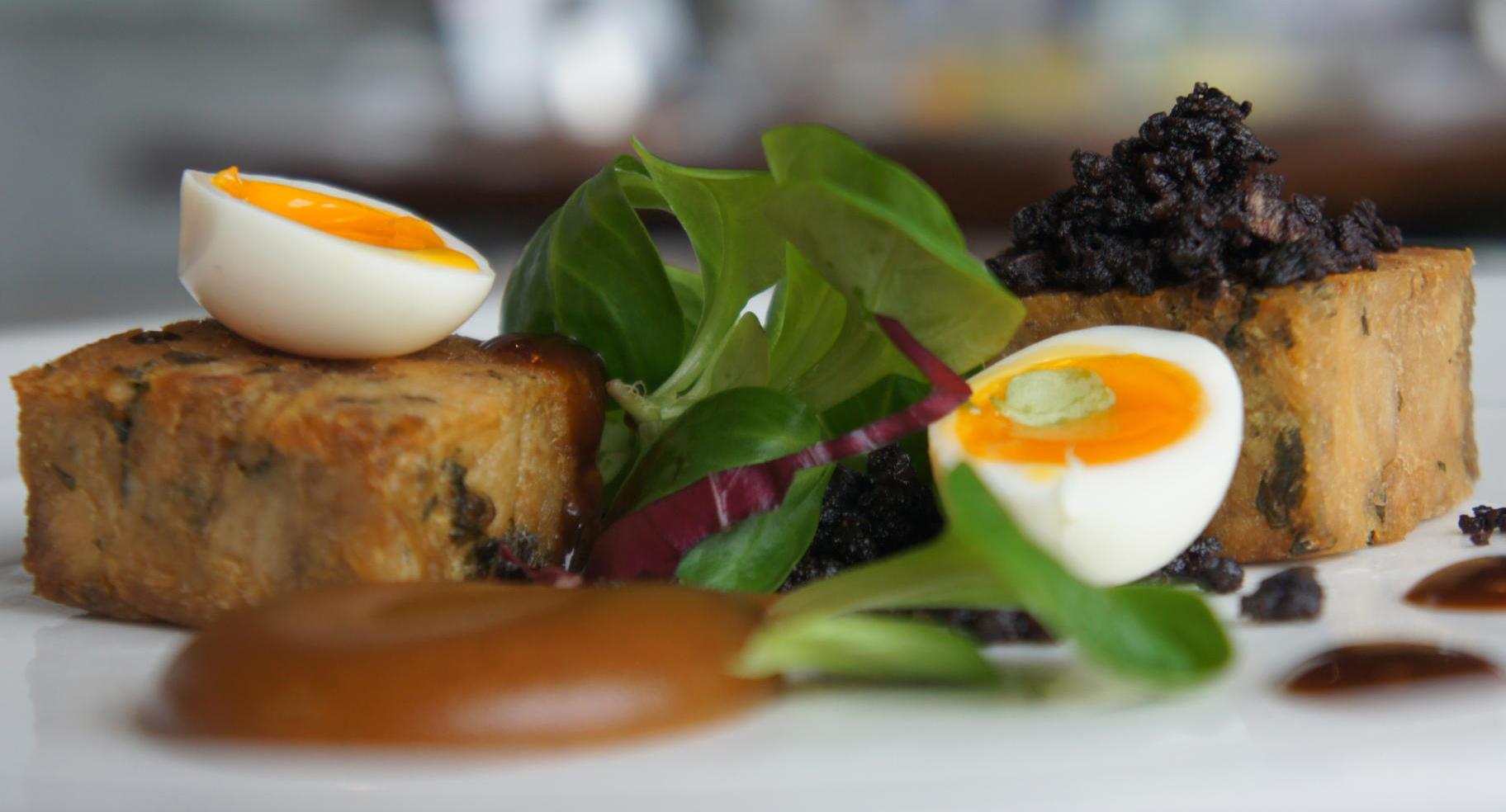 Warm duck and pork presse, burnt apple puree, black pudding crumble, soft boiled quail's egg