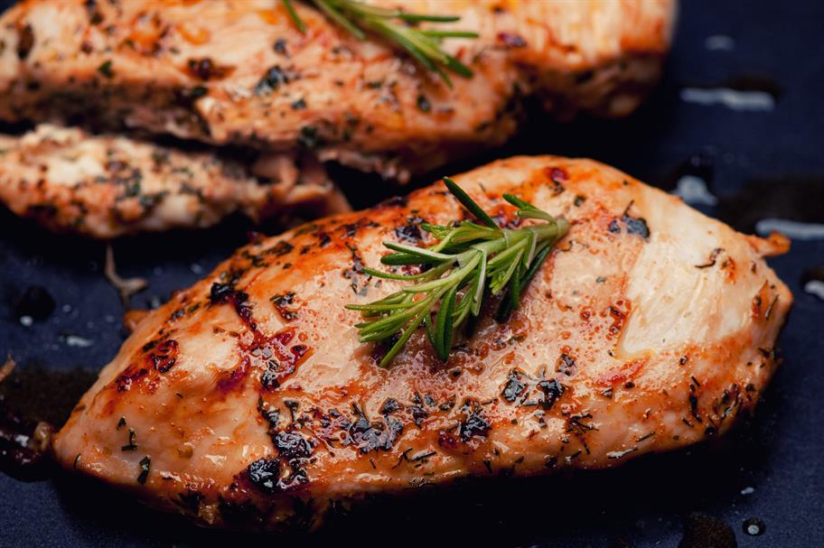 chicken breast cooked with a sprig of rosemary