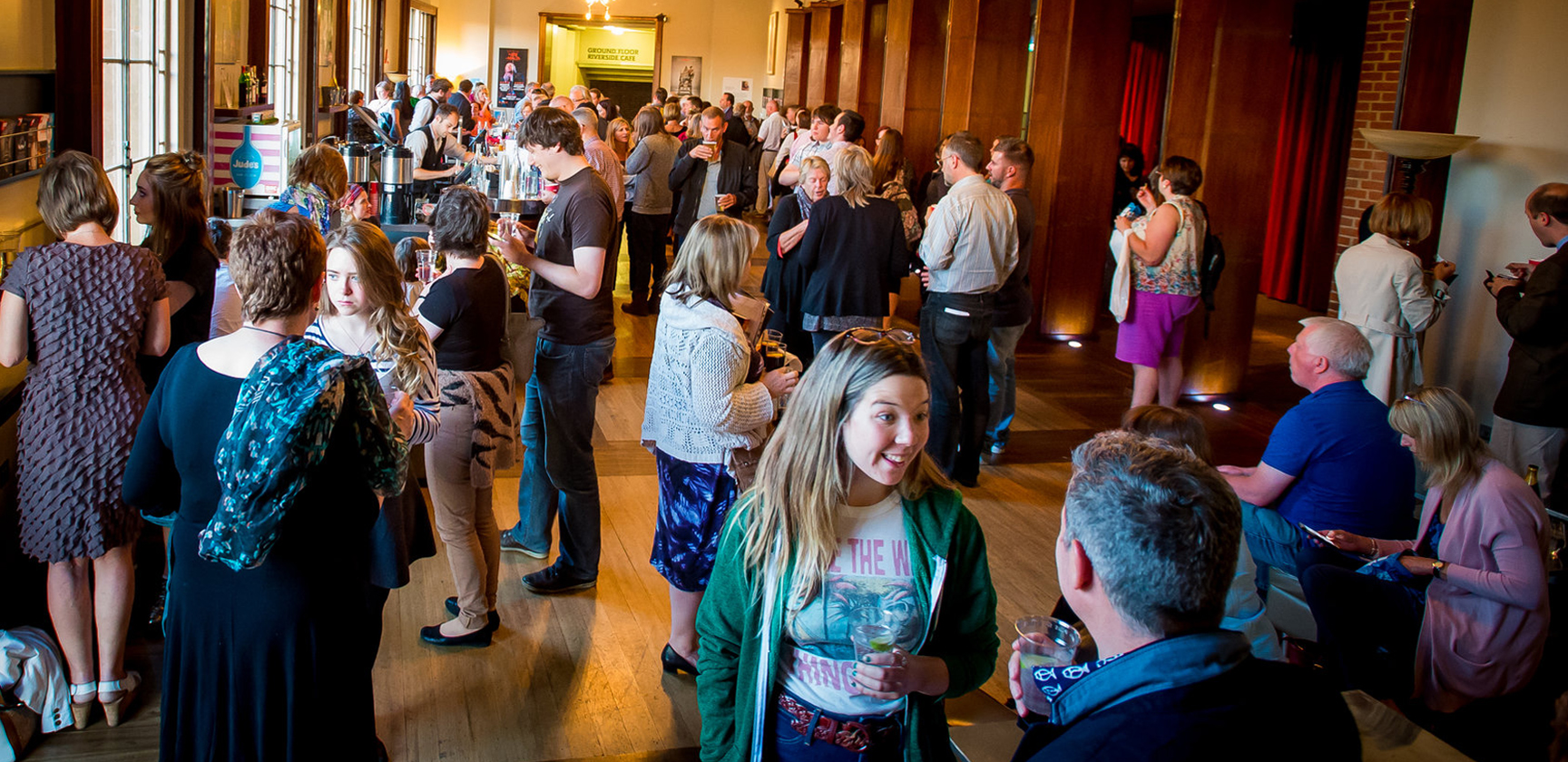 People enjoying interval drinks in the Upper Circle bar.
