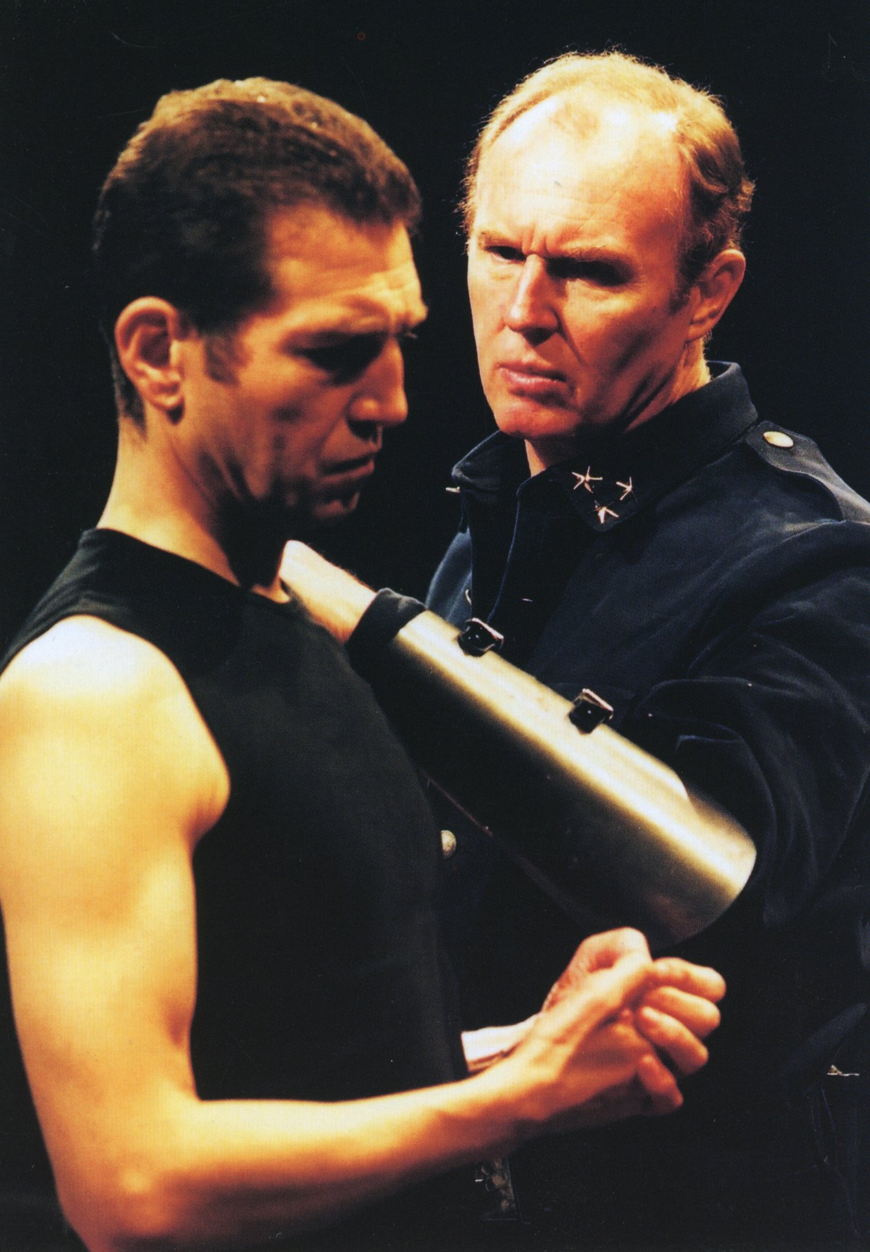 Cassius and Brutus prepare for war in the 2001 production of Julius Caesar.