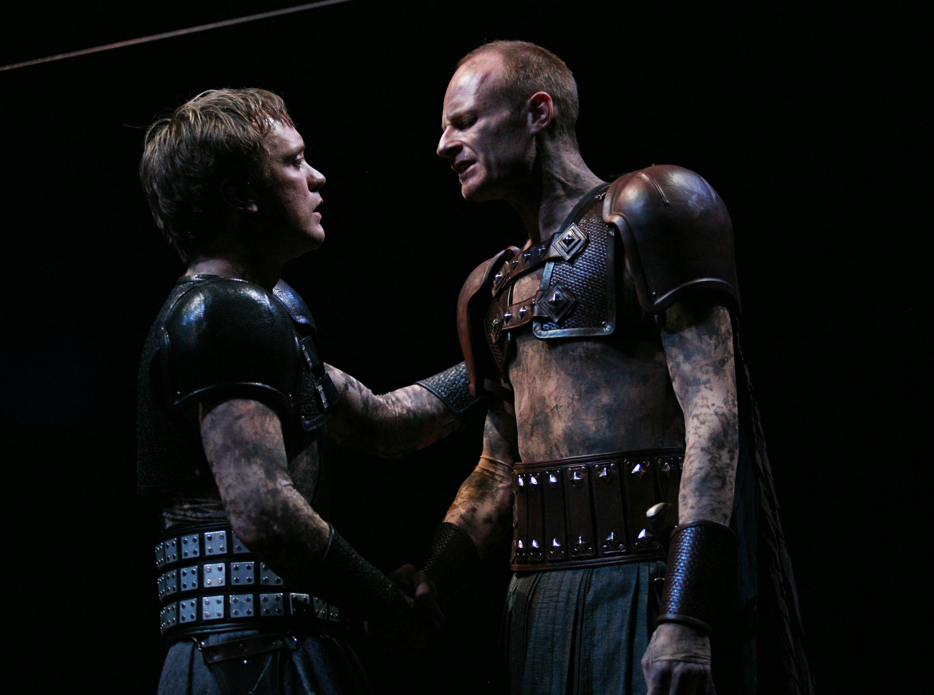 Cassius and Brutus speak to each other as they prepare for war in the 2009 production of Julius Caesar.