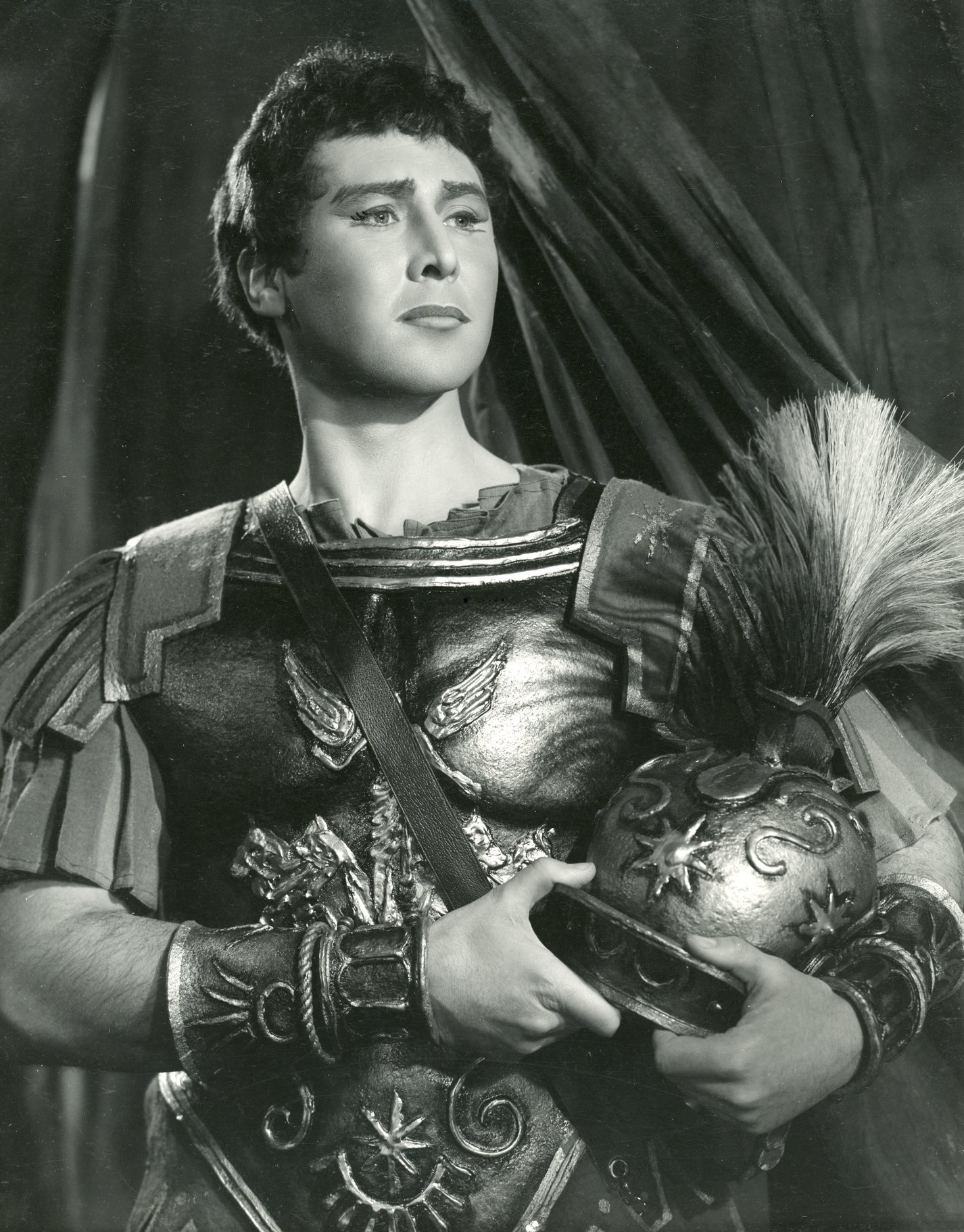 Mark Antony wearing roman armour, holding a helmet under his left arm