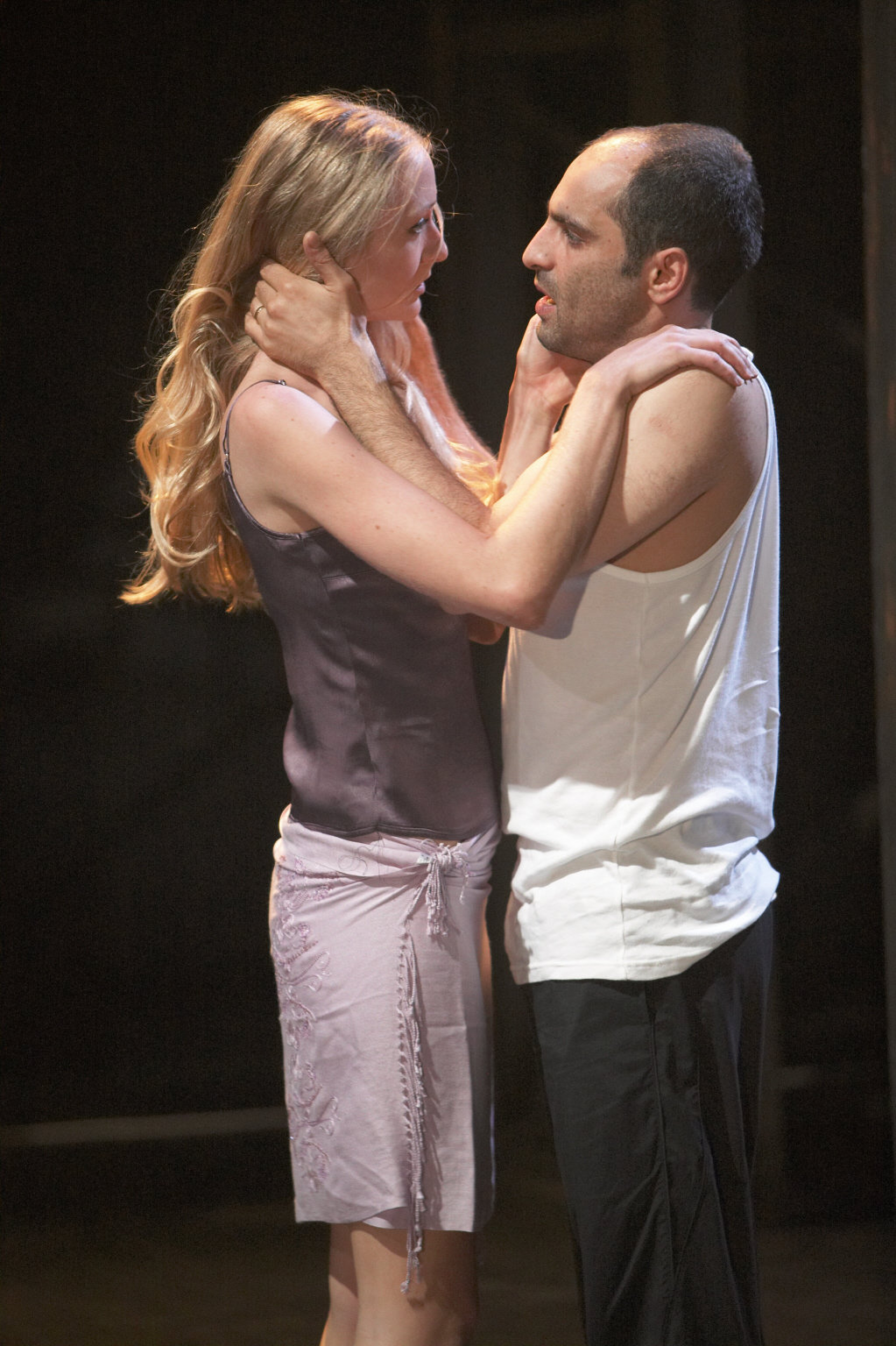 Portia and Brutus stand face to face in the 2004 production of Julius Caesar.