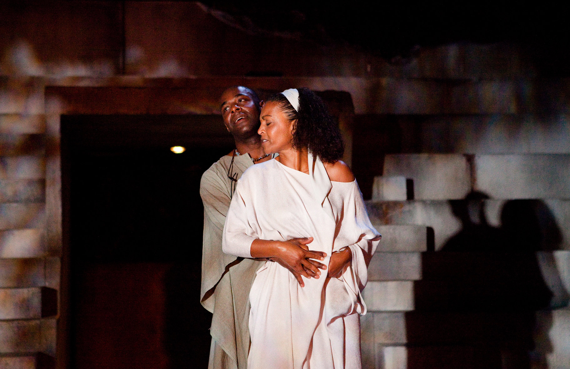 Portia and Brutus stand together in an embrace in the 2012 production of  Julius Caesar.