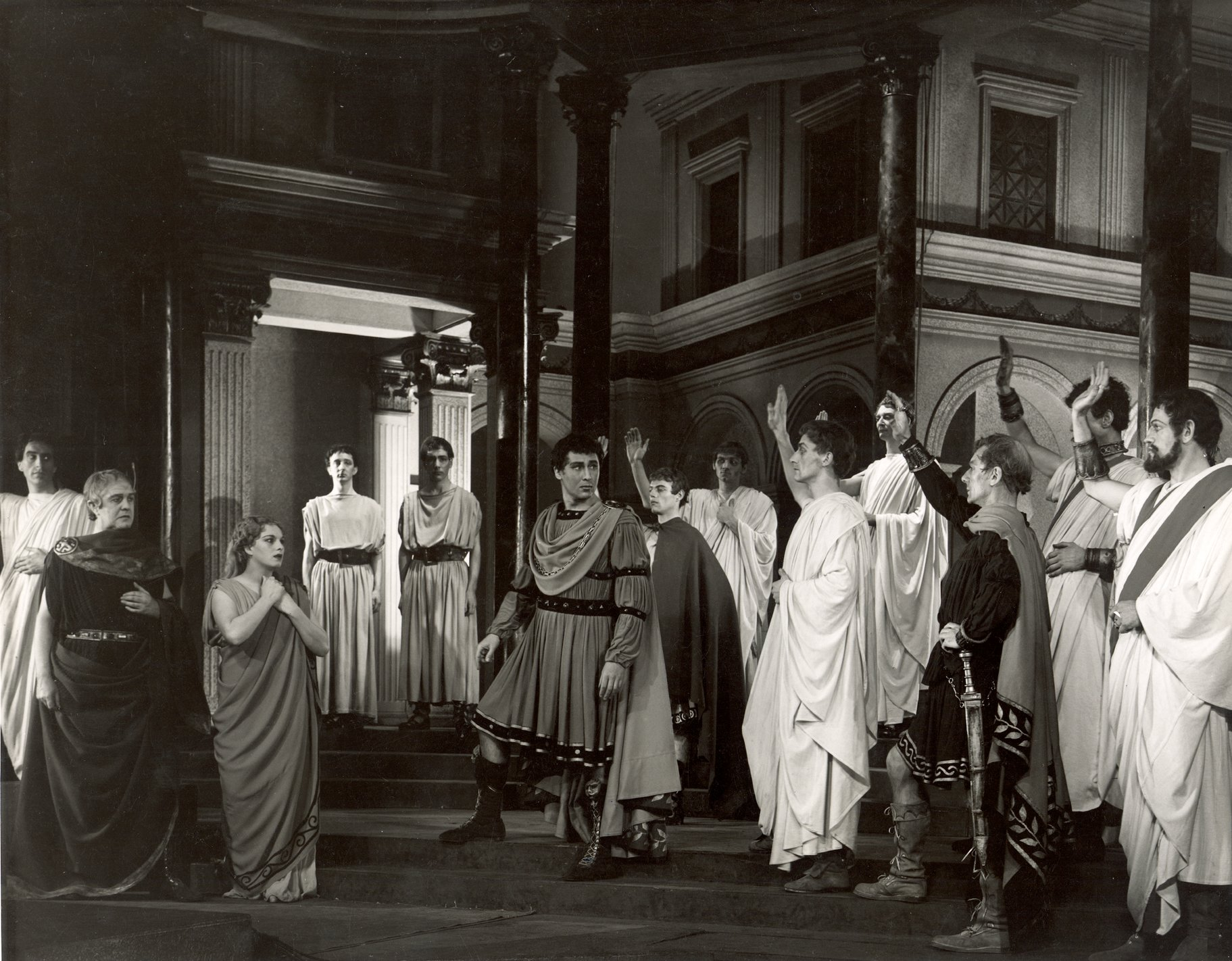 Citizens saute Julius Caesar during a parade through the streets of Rome