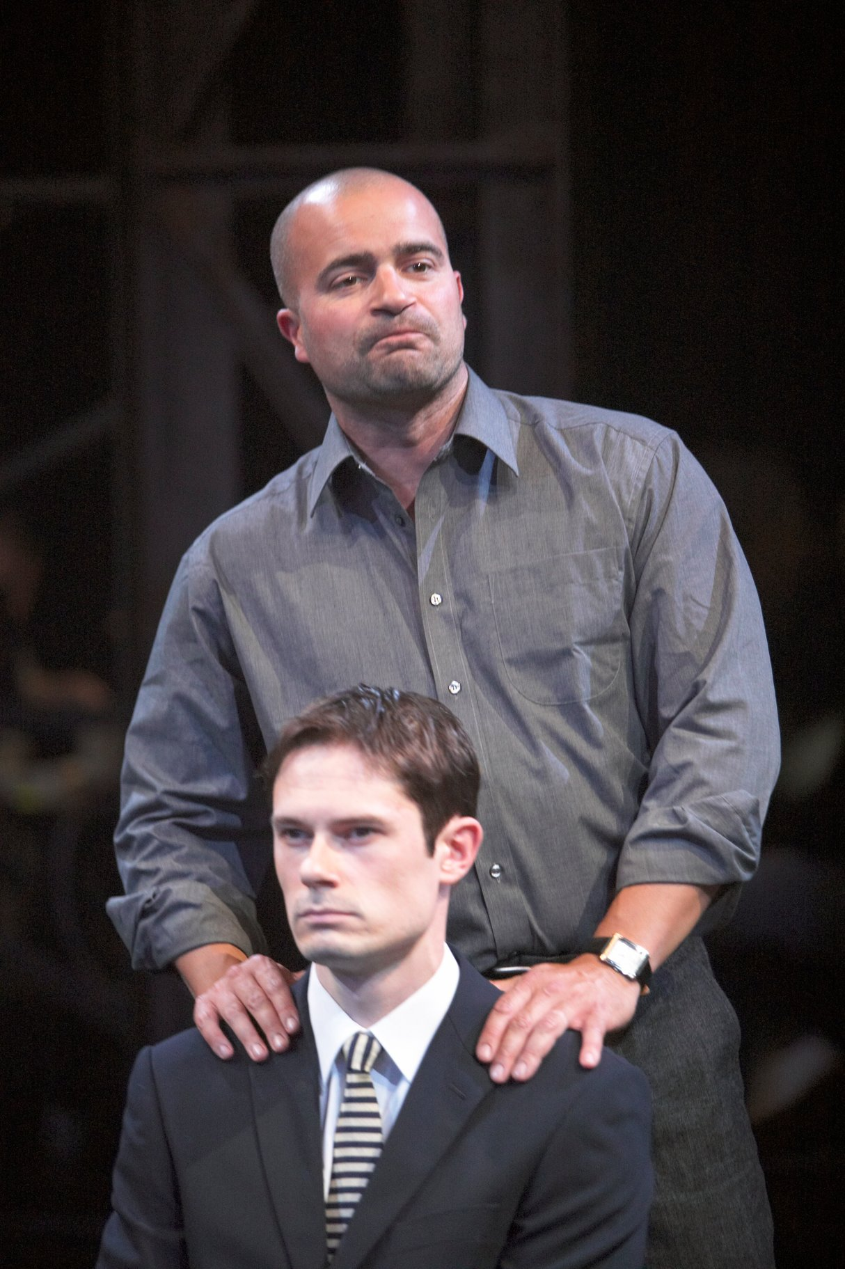 ​Mark Antony standing behind Octavius Caesar with his hands on his shoulders in the 2004 production of Julius Caesar.