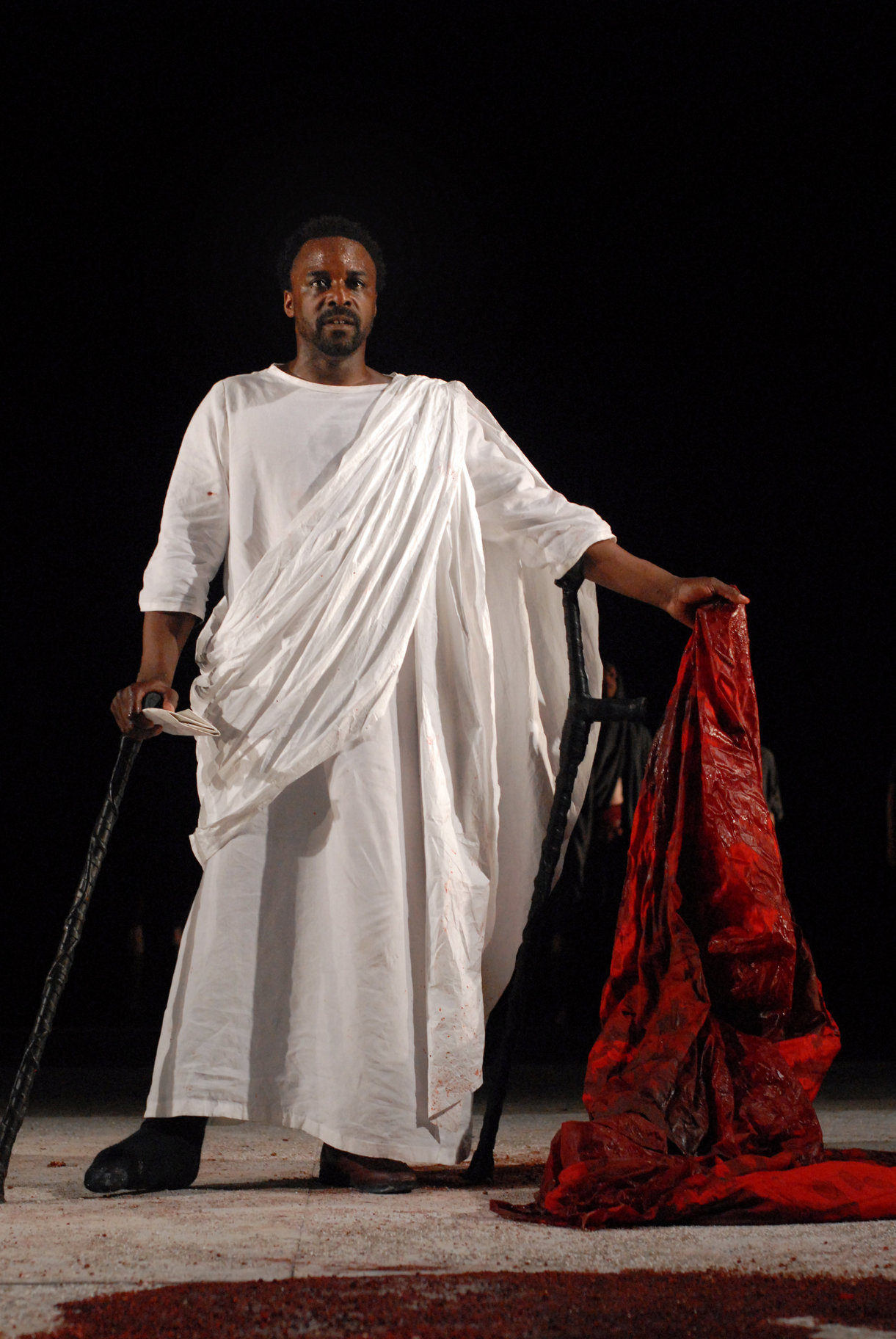 ​Mark Antony stands with crutches and a letter in one hand and Caesar's bloodied robe in the other in the 2006 production of Julius Caesar.