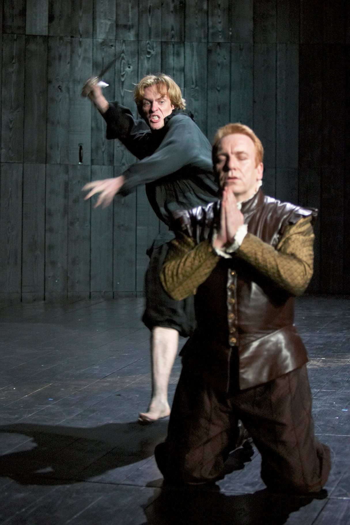 Hamlet prepares to strike at the praying Claudius