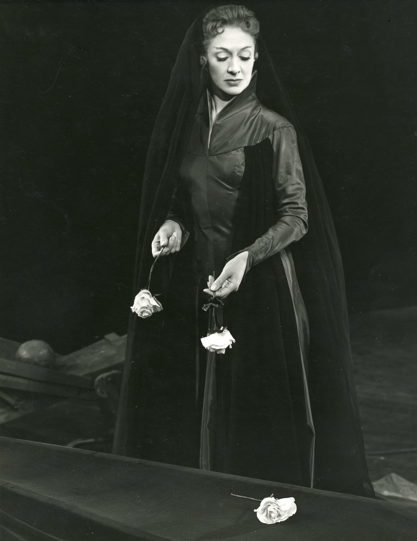Gertrude with roses at Ophelia's grave.