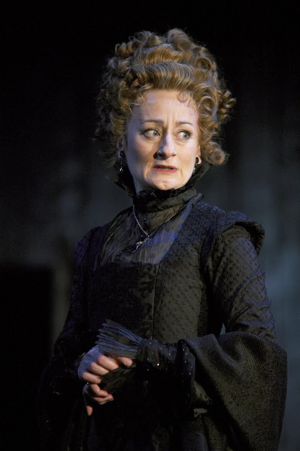Gertrude in a black dress.