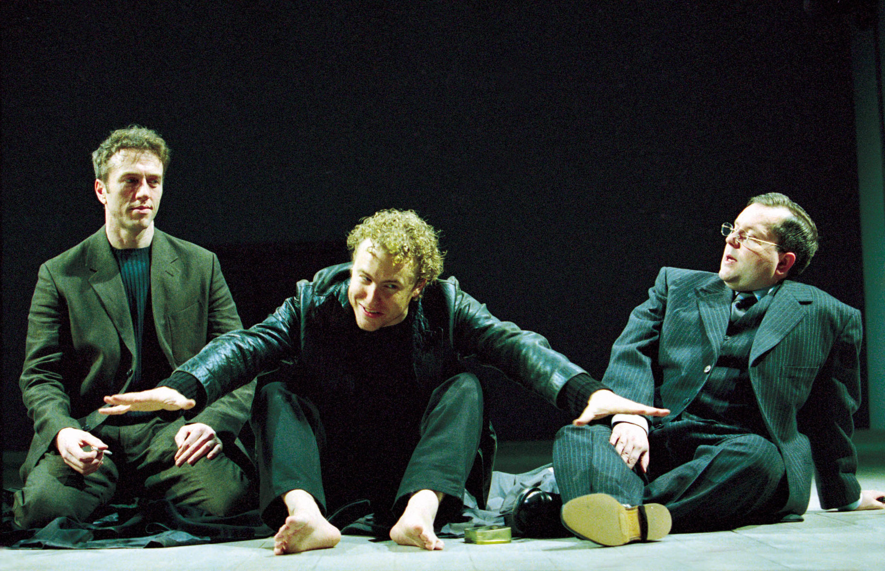 Hamlet in between Rosencrantz and Guildenstern.