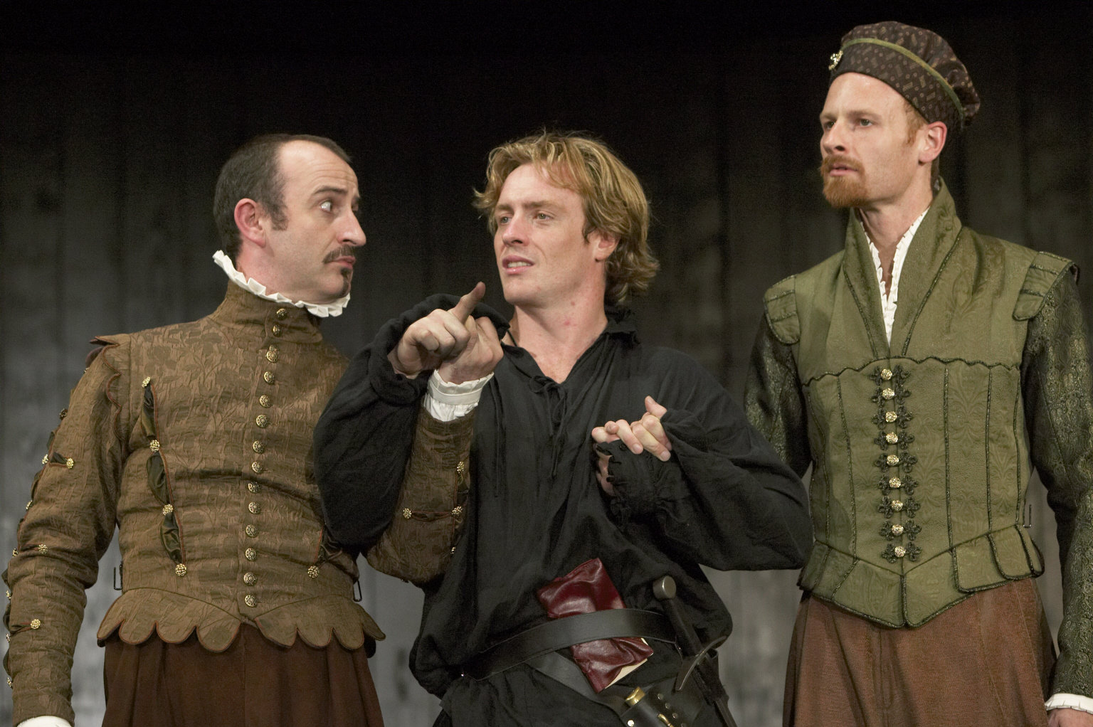 Hamlet between Rosencrantz and Guildenstern.