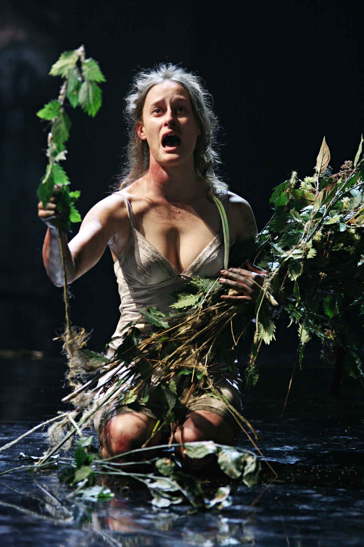 The mad Ophelia with arms full of weeds.