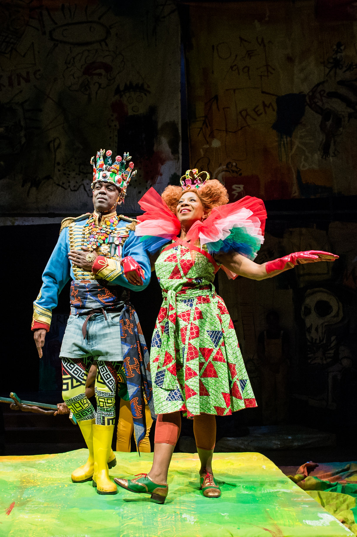 The Player King and Queen in vibrant multicoloured costumes.