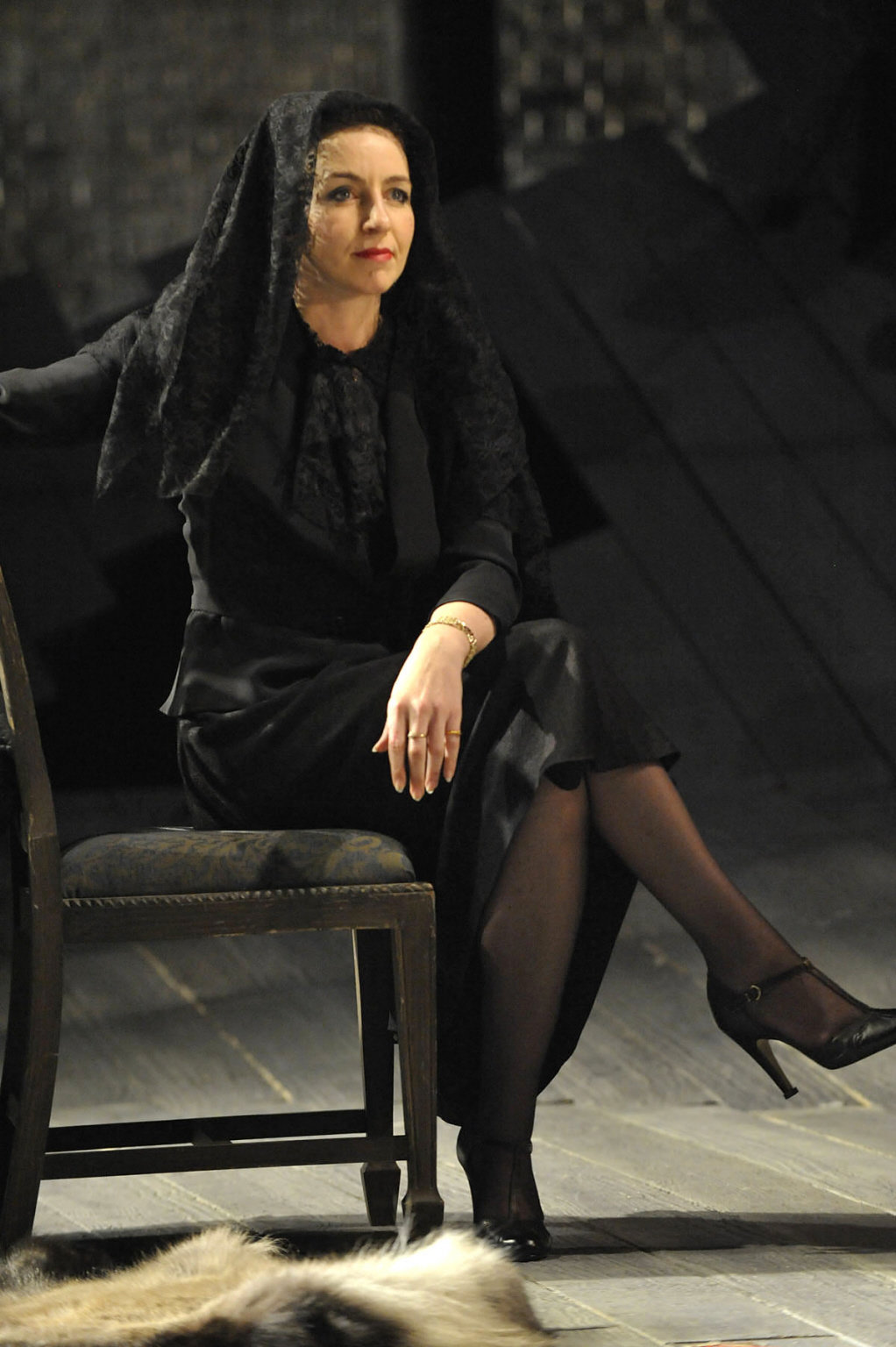 Olivia sat cross legged on a chair wearing black with a drawn veil on her head in the 2012 production of Twelfth Night.