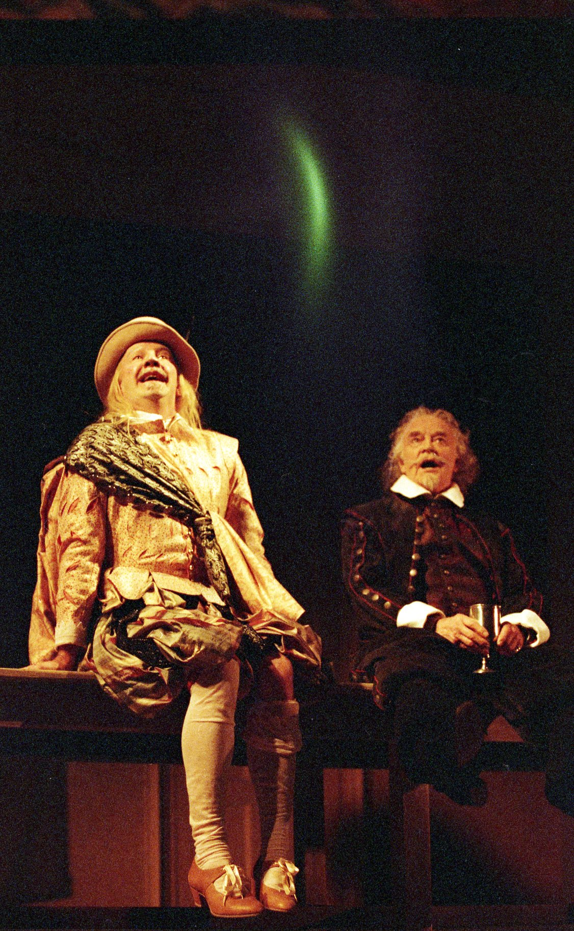 Sir Andrew (right) and Sir Toby (left) sitting looking upwards
