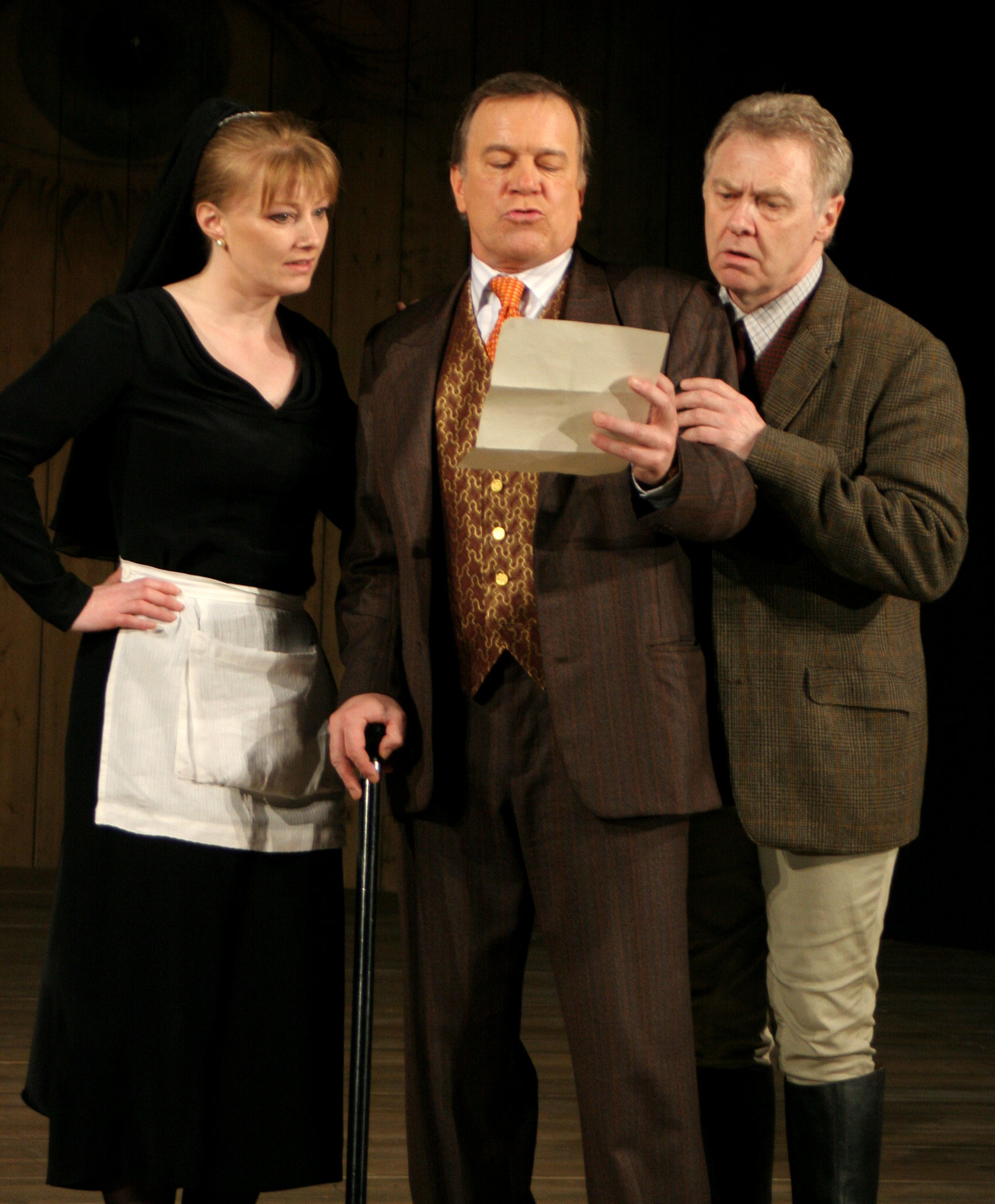 Maria (left), Sir Toby(center) and Sir Andrew (right), standing reading a letter