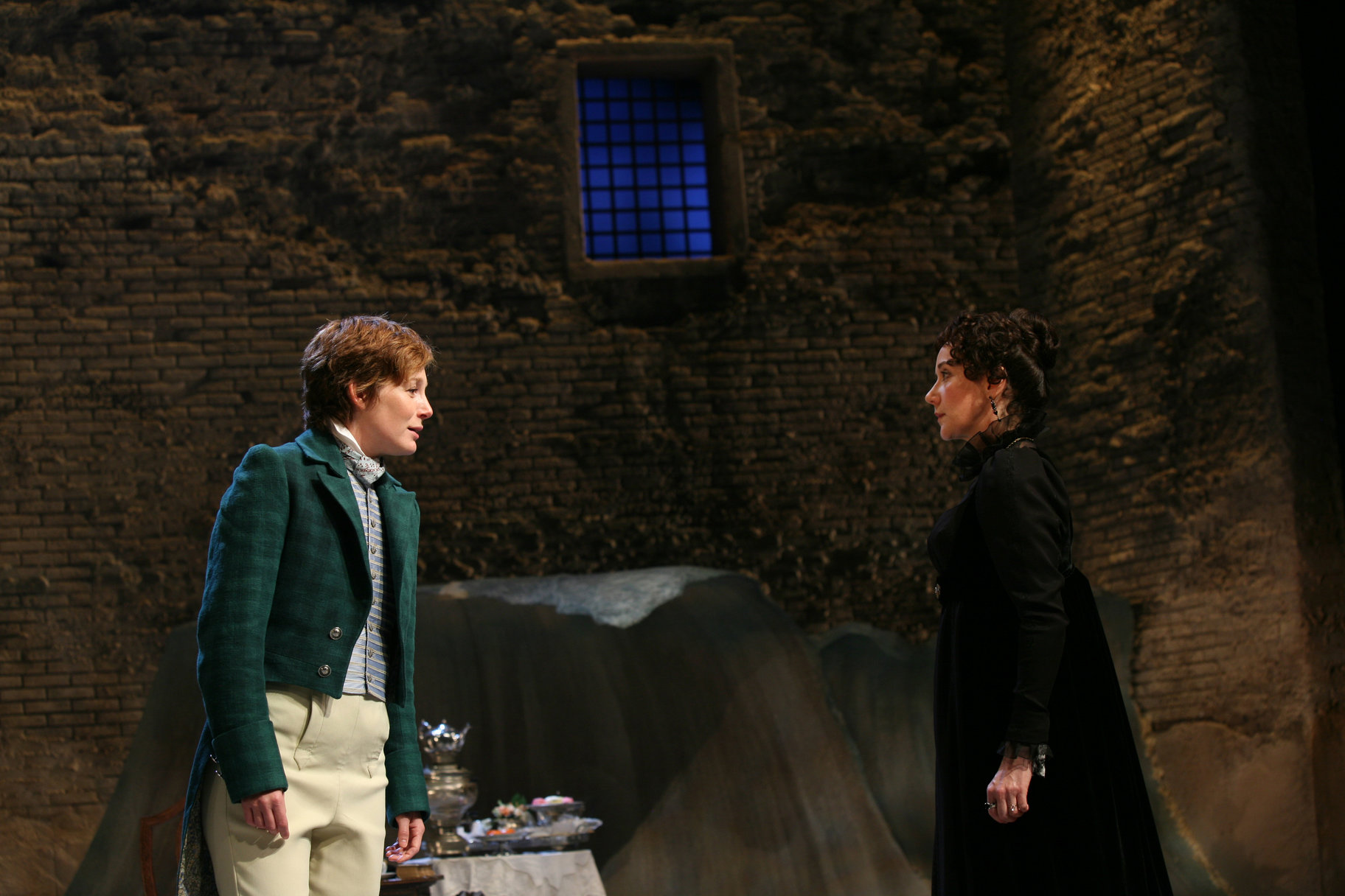 Olivia and 'Cesario' stare at each other, standing apart, in the 1955 production of Twelfth Night.