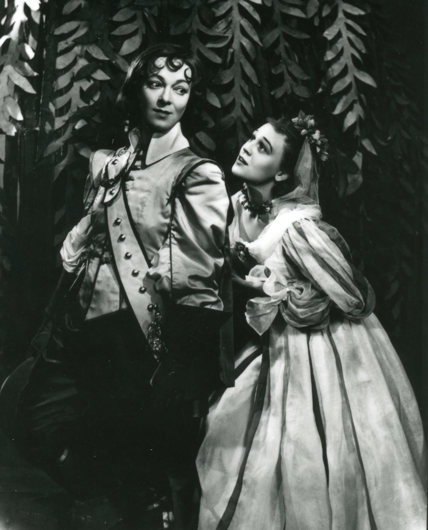 Olivia stands behind 'Ceasrio' and clutches at 'his' arm in the 1947 production of Twelfth Night.