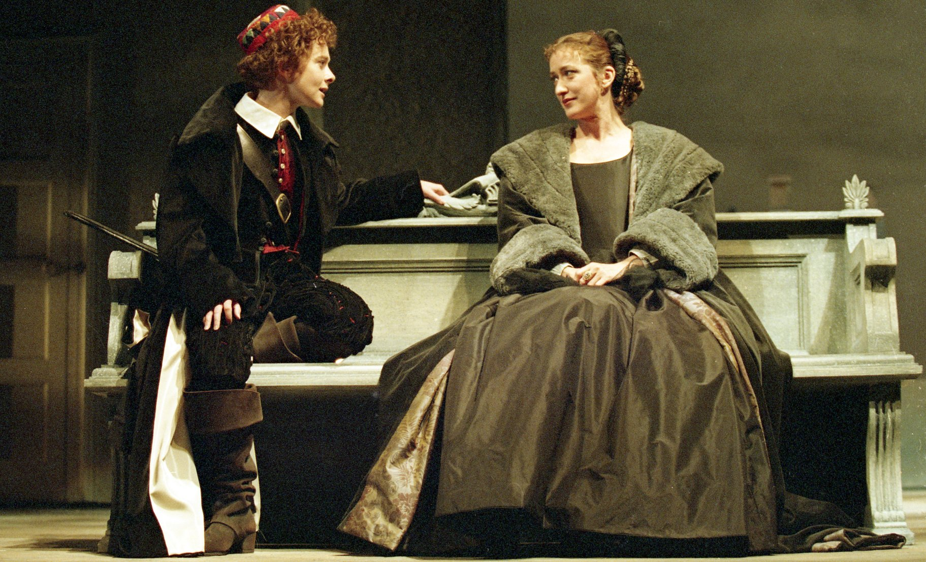 Olivia sits at a bench with 'Cesario' in the 1994 production of Twelfth Night.