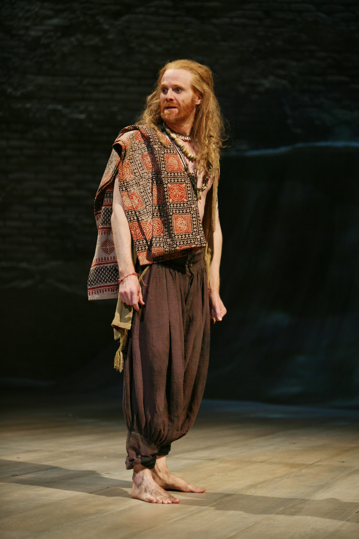 Antonio stands barefoot wearing loose clothes and a scraf in the 2009 production of Twelfth Night.
