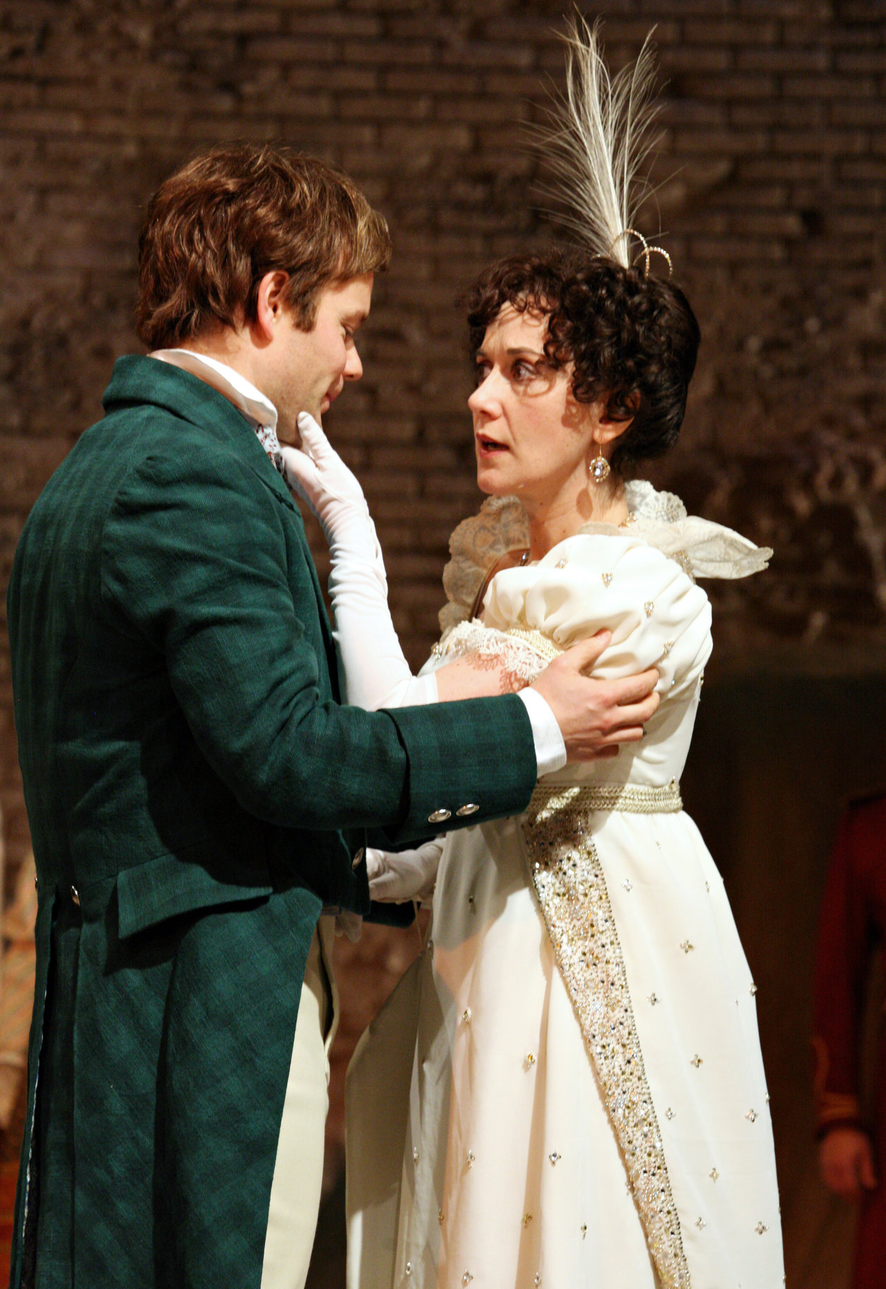 Sebastian in a green suit and Olivia in a wedding dress embrace in the 2009 production of Twelfth Night.