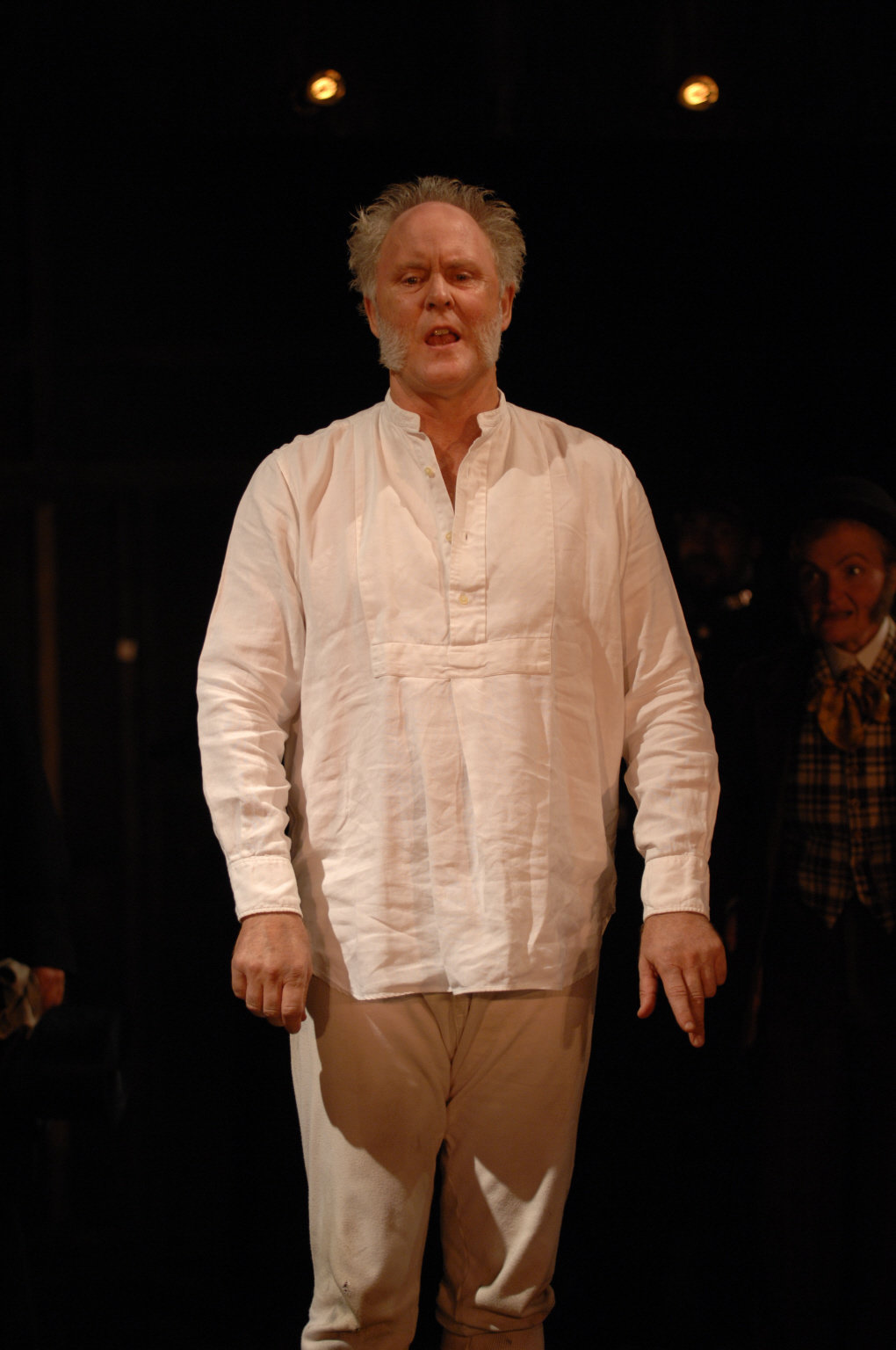Malvolio dressed in his underclothes and looking confused, stands in the 2007 production of Twelfth Night.