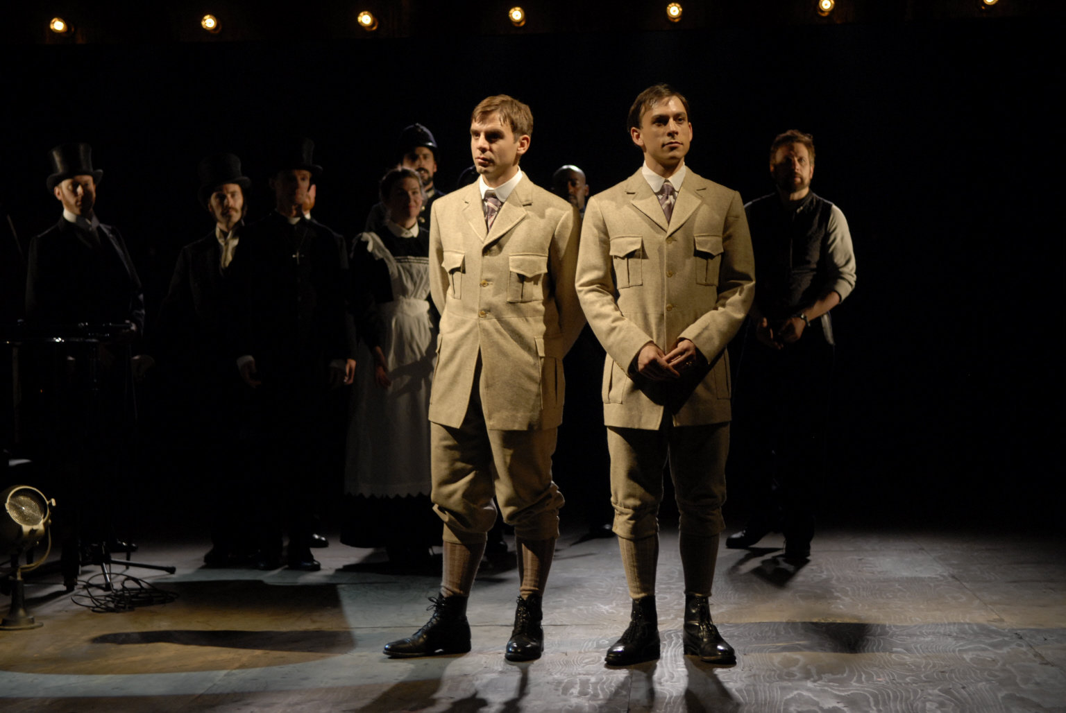 Viola and Sebastian  stand side by side in the same beige suit in the 2007 production of Twelfth Night.
